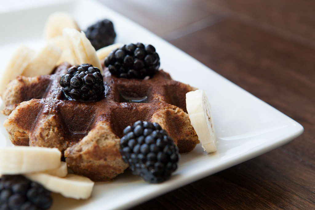 Paleo Almond Flour Waffles with Maple Syrup and Berries