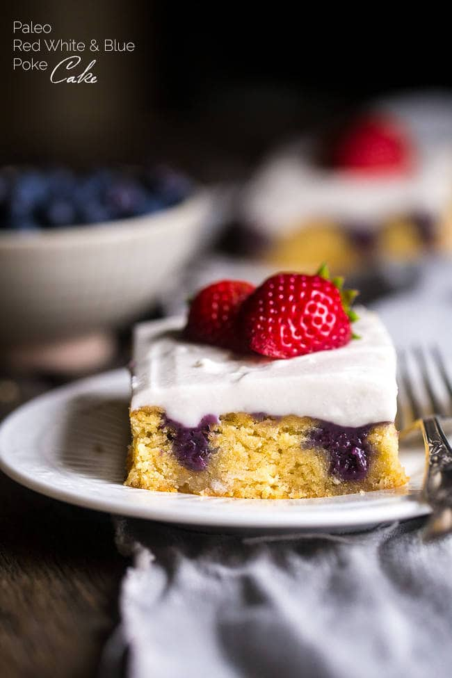 PALEO POKE CAKE WITH BLUEBERRIES, STRAWBERRIES AND COCONUT CREAM
